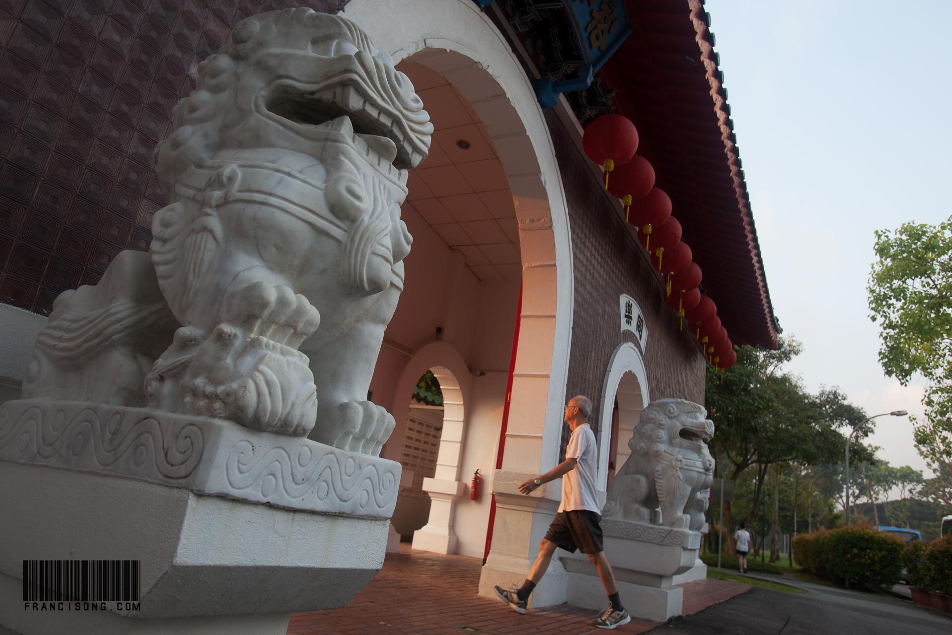 Man entering chinese gardens
